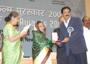 Dr. A.V. Anoop receiving the Rajat Kamal